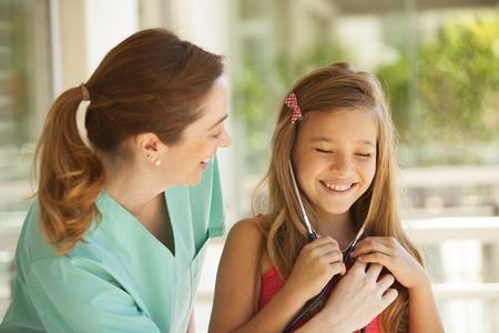 medical exam: Little girl and pediatrician