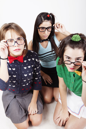 girl studying: Group of teenager nerd friends Stock Photo