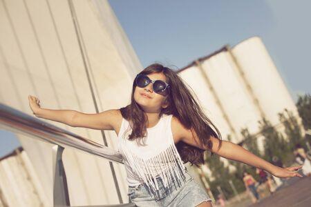 mujer: Happy girl in Puente de la Mujer, Buenos Aires Argentina Stock Photo