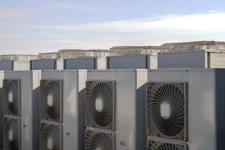 coolant temperature: Air conditioning system assembled on side of a building.