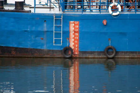 depth measurement: Orange and white scale on a blue boat