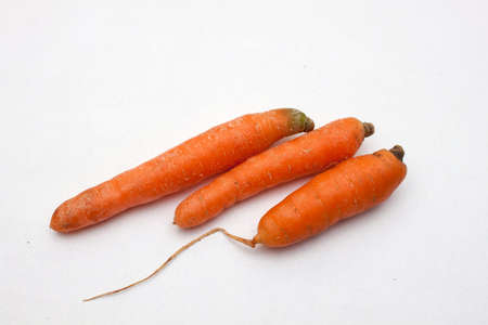 medium size: Three carrot on a white background