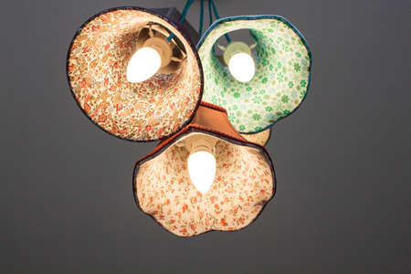 household fixture: Colorful chandelier on the ceiling on white background