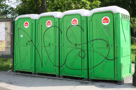 personal perspective: A row of four portable toilet bathroom in Tmisoara Romania Stock Photo