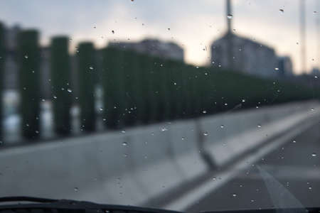 View through a windshield on a rainy day