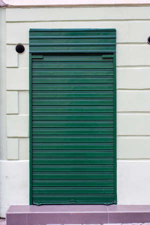 foreclosed: A closed shop with a metal gate. Stock Photo