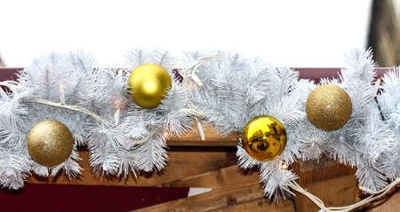 fake christmas tree: Gold Christmas balls on the  white branch
