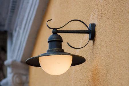 slantwise: Decorative street lamp lit at dusk