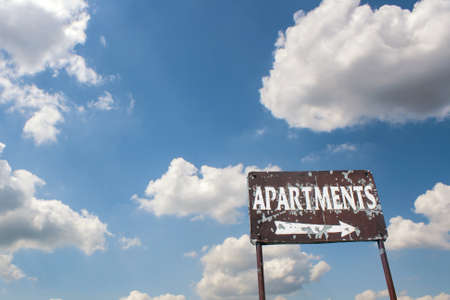 apartment for rent: A old sign advertising an apartment for rent