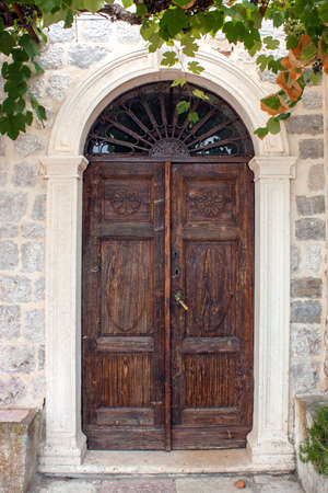 architectural feature: Old brown front door - the picture was taken in Rose.