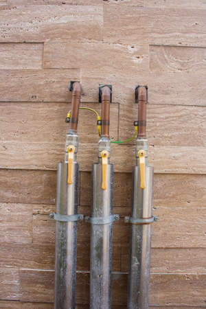 stop gate valve: Set of metal pipelines with yellow valves