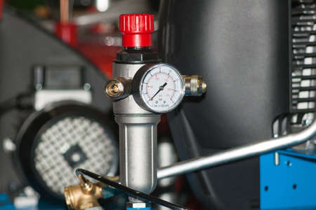 The pressure gauge on the air compressor