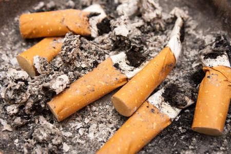 self harm: Close up shot of cigarette butts.