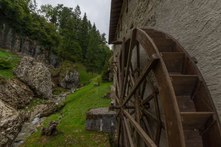 A watermill or water mill is a mill that uses hydropower. It is a structure that uses a water wheel or water turbine to drive a mechanical process such as milling (grinding), rolling, or hammering