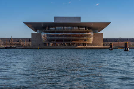 Copenhagen Opera House at dusk, horizontal image of building on water, contemporary European architecture