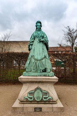Statue of Caroline Amalie of Augustenburg in the Rosemborg Castle Park in the city of Copenhagen in Denmark Editorial