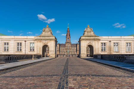 Entrance of Christiansborg Palace in Copenhagen, Denmark. Great building of the Danish Royals under a blue sky on a sunny day