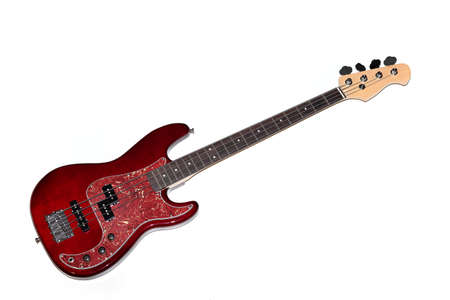 Four-stringed bass guitar in cherry-colored wood against a black background, a horizontal image
