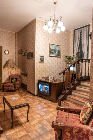 Interior of a fifties house, wooden details and wallpaper on the walls, vertical image Reklamní fotografie