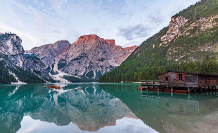 Panorama of Lake Braies with the Dolomites, Croda del Becco, in the background and the stilt house on the right from where you can go for a boat ride on the lake