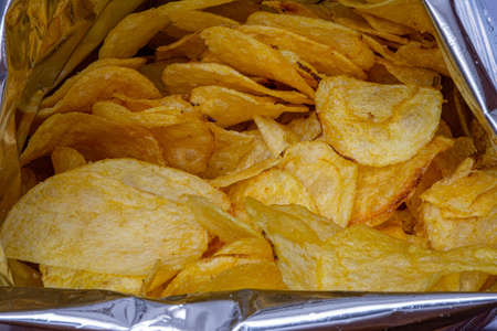 Chips in aluminum paper bag, food photography