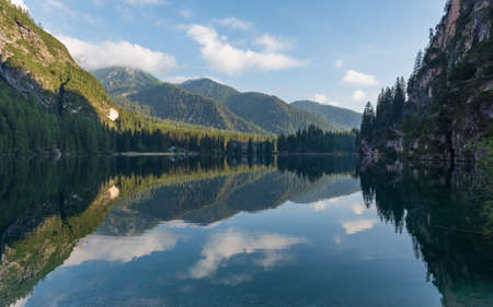 Mountain landscape reflected in the waters of Lake Braies, Italian Dolomites in South Tyrol