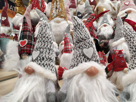Christmas decorations displayed in a shop, puppets with the features of gnomes