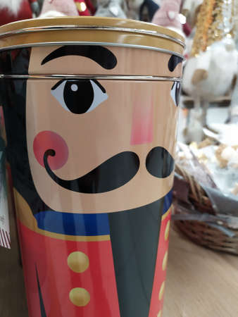 Christmas decorations displayed in a shop, colored tin that reproduces a nutcracker soldier