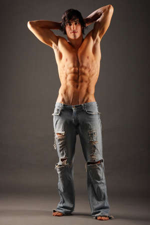Young very muscular half-naked male standing in a pair of torn jeans Stock Photo - 6485388