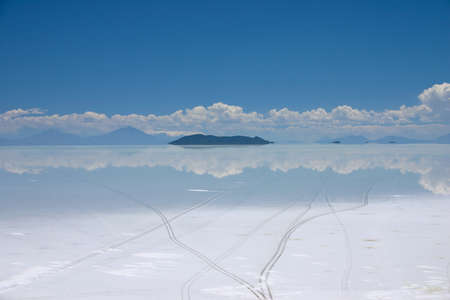 high plateau: View of the salt lake of salar de uyuni in Bolivia showing tire tracks Stock Photo