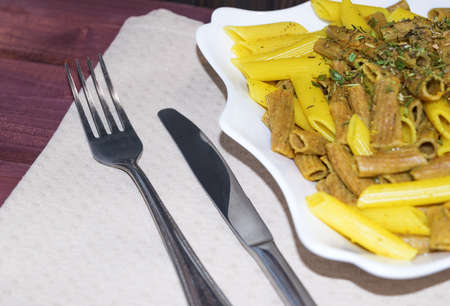 herbs de provence: Mixed rye and classic wheat pasta with spices and herbes de Provence