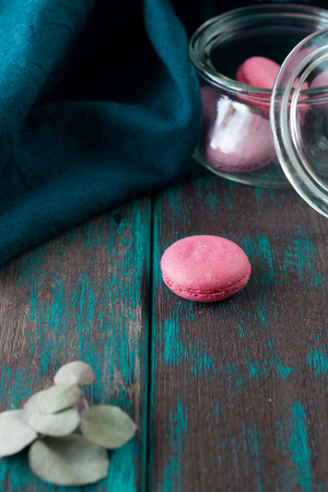 Group of macarons made of strawberries, cream, chocolate and blueberries. Rustic photo. Toned. Stock Photo - 106306670