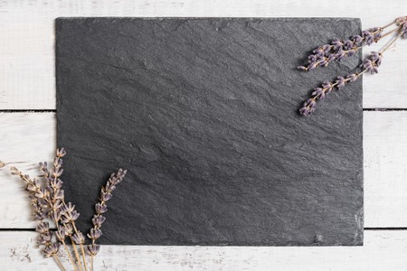 Lavender on white rustic wooden desk. Toned photo. Space for text. Selective focus.