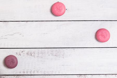 Group of macarons made of strawberries, cream, chocolate and blueberries. Rustic photo. Macro.