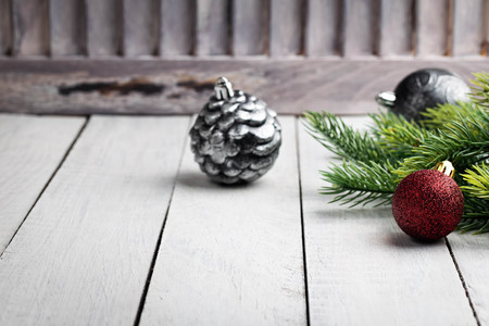 Christmas decorations with fir branches on white wooden desk. Christmas decoration. Space for text.