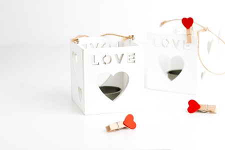 Two cube candlesticks on white with hearts. Valentines Day concept. 14th February. 版權商用圖片