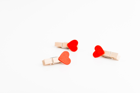 Three cloth pin with heart. Space for text. Valentines Day. Love concept.