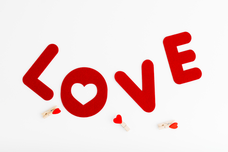 Love word on white with cloth pins. Valentines Day. Love concept.