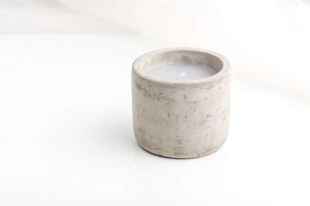 Single concrete candle with essential oils. Minimalism concept. Spa. 版權商用圖片