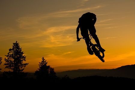 mountainbike: bmx rider on sunset sky