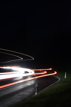 nightly lights from cars in a curve Stock Photo