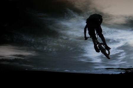 bmx rider against sky at sundown