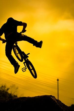 extreme weather: bmx rider on failed jump Stock Photo