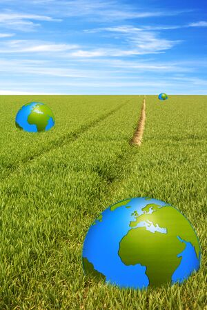 globalism: world globe in green field with a path