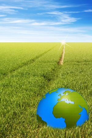biologic: world globe in green field with a path symbolic for the future Stock Photo