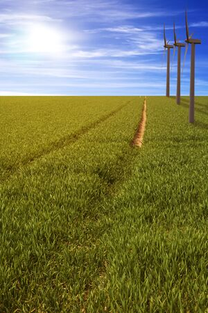 globalism: windmill in a gren field with a path Stock Photo