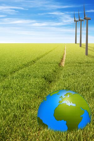 globalism: windmill and earth in green field with path symbolic for the future energy