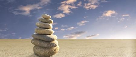 zen stones on sand panorama