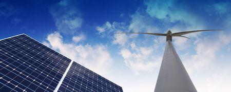 solarenergy: Windmill and Solar panel against cloudy sky