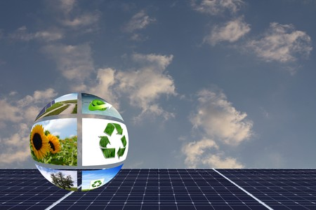 solarpower: symbolic natural ball on solar panel with space for your text Stock Photo